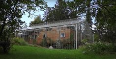 Ingenious Couple Wrapped Their House in a Giant Greenhouse to Keep It Warm - My Modern Met