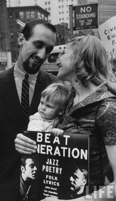 "Noel ""Paul"" Stookey and Mary Travers (and baby Erika) of Peter, Paul and Mary. protesting the closing of Greenwich Village coffee houses in NYC, 1960.    Photo by Bob Gomel.  via"