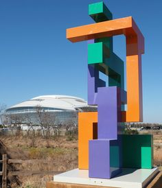 """Artist Art Fairchild created this """"Trio"""" sculpture. It's located on the Sculpture Trail along Johnson Creek east of AT&T Stadium. Park on a Rangers' lot off Randol Mill to visit the park, but take note: Avoid game or event days for the Cowboys or Rangers. During those times there is no such parking."""