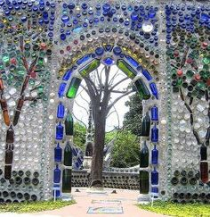 Glass bottle wall + arch, Airlie Gardens, near Wilmington, North Carolina Reuse Wine Bottles, Recycled Wine Bottles, Recycled Glass, Glass Bottles, Bottle Candles, Beer Bottles, Empty Bottles, Mosaic Bottles, Milk Bottles