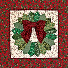 """Quilted Holiday Dresden Wreath, 26"""" x 26"""", by Vicki Dobbins. Made using the pattern in Egg Money Quilts by Eleanor Burns."""