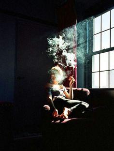 Smoking girl photographed by Nan Goldin