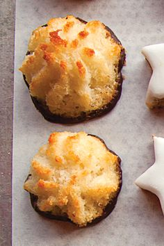Kokosmakronen (Chocolate-Dipped Coconut Macaroons)   Ye old Macaroon just got better: A skirt of silky chocolate makes these traditional favs the perfect addition to your holiday platter  Recipe - Saveur.com