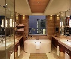"""Peninsula Tokyo This hotel takes bathrooms seriously. The marriage of technology and luxury is seamless with an """"invisible"""" TV set into fog-free mirrors, only noticeable once you turn it on. Peninsula Tokyo, Peninsula Hotel, Japon Tokyo, Smart Toilet, Best Honeymoon Destinations, Romantic Destinations, Overwater Bungalows, Tokyo Hotels, Palace Hotel"""