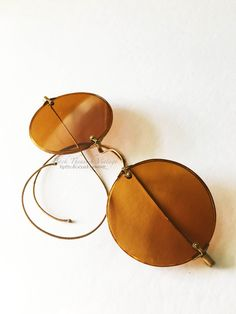 Will suit every alter ego darlin. Finely crafted Willson 1920's Orange Non Rx Glass Sunglasses with amber celluloid rims and brass saddle bridge mounts and coil temples.