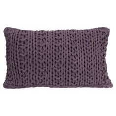 Add a touch of texture to your living room sofa or reading nook arm chair with this charming cotton pillow, showcasing a crocheted design in purple.
