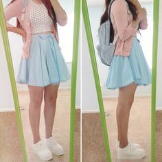 pink cardigan, polka-dotted crop top, light blue skater skirt, backpack, and white platform sneakers