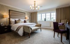 Warm mulberry accents teamed with muted golds turn a neutral space into something very luxurious