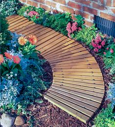 These garden path ideas are awesome! I found some great inspiration for the new gravel walkway with stepping stones I want to install in my front yard. But there's also great ideas for brick, wooden, mulch, grass, stone and flagstone paths and walkways. Wood Walkway, Wooden Path, Backyard Walkway, Flagstone Path, Outdoor Walkway, Wooden Garden, Backyard Landscaping, Gravel Walkway, Walkways
