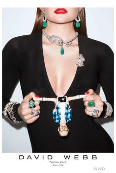""""""" The famed photographer,Terry Richardson, did double duty for the Carine Roitfeld-styled series of print ads for the fine jewelry brand when he shot the campaign, which also features a plastic, doll-sized version of himself front and center (holding a strategically placed camera)."""""""