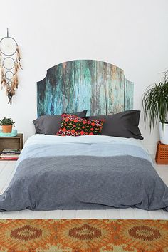 Don't care for the colors but the idea of staining a headboard w/water color esque design + simple sheets - mmm hnmmmm!