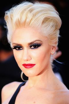 Gwen Stefani....I love her style..and shes so pretty...she's the only person that can pull off red lipstick