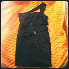 I just discovered this while shopping on Poshmark: L.A.M.B. black asymmetrical dress. Check it out!  Size: 10