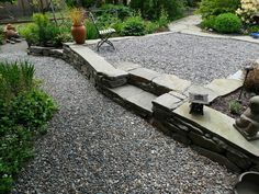 """""""For soft gravel patios I like to use 3/4 inch round rock. I dig an area out flat so that I can spread it at least 3"""" thick and have the top be at the desired grade. I rake it smooth and hose it down to clean it.Instant patio! Pea gravel, which is smaller and more common, is an option too, but I find it sticks to the feet and in the soles of some shoes and gets tracked around. The 3/4 round rock tends to stay in place and is prettier. I never put landscape fabric underneath. Jeffrey Bale"""