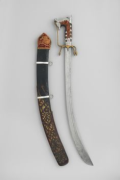 """Сабля -""""Нимча"""" This distinctly North African sword, or nimcha, probably dates from around the battle of Oran when that city, a haven for Turkish pirates, was besieged by the Spanish. The openwork leather scabbard shows Ottoman influence Swords And Daggers, Knives And Swords, Medieval Weapons, Arm Armor, Cold Steel, Heritage Image, 18th Century, Blade, Knifes"""