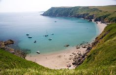 Lantic Bay, Fowey, Cornwall, England. One of the best hidden beaches in England! To the west of wild Pencarrow Head, set just beneath the cliffs, walk down well made steps surrounded by wildflowers to discover two stunning beaches (Great Lantic and Little Lantic). At low tide there are lovely easy-access rock pools full of sea life and a good stretch of sand for playing on.