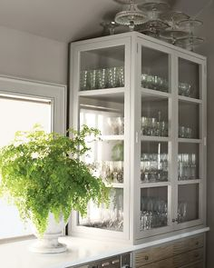 Kitchen. Martha Stewart's kitchen inspiration: glass- sided china cabinetry. Pretty.