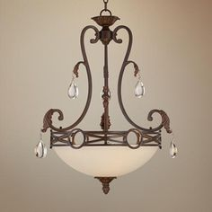 Inspired by beautiful, wrought iron chandeliers, this cream glass bowl pendant light features an elegant scrolling frame.