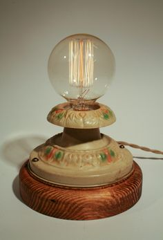 Bare Edison Bulb Lamp with Vintage Hand Painted Metal top. $230.00, via Etsy.