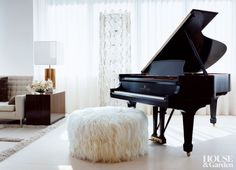 An angora goatskin pouf serves as a bench for a Steinway grand piano in this ethereal Manhattan living room. Grand Piano Room, Piano Room Decor, Piano Living Rooms, Living Room Decor, Living Spaces, Baby Grand Pianos, Mid-century Modern, Contemporary, Small Room Bedroom