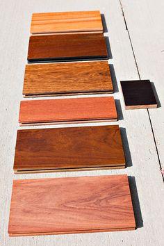 Wood Floor Samples - From bottom to top, Angico (Vermelho), Brazilian Walnut (Ipe/Lapacho), Brazilian Teak (Cumaru), Tiete Chestnut (Sucupira), Malbec Walnut (Lapacho), Afzelia, Woven Espresso Bamboo (right) #BR-111 #wood #flooring