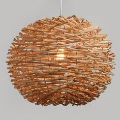 Handcrafted by Filipino artisans of natural wicker, our exclusive pendant shade is woven into a round bird's nest shape that beautifully filters light. The unfinished wicker produces slight color variations that make each piece unique. Pendant Lighting Bedroom, Pendant Chandelier, Hanging Pendants, Pendant Lights, Chandelier Lighting, Chandeliers, Hanging Light Fixtures, Pendant Light Fixtures, String Lights