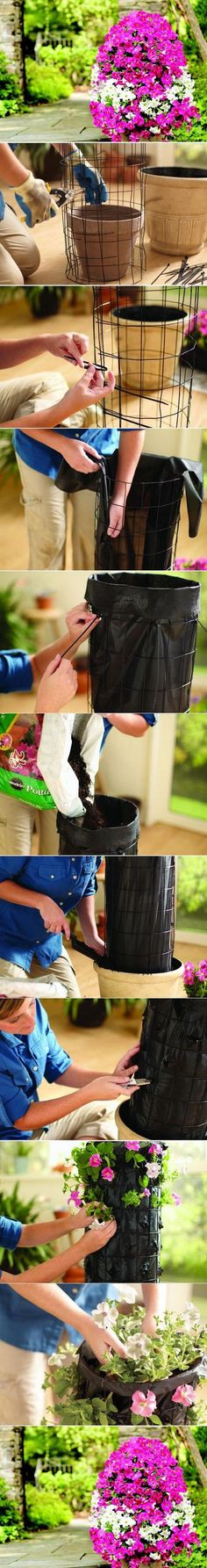 Planters for the garden. Easy and cheap to make. Fill with your favourite blooms, can also be used to grow strawberries for a vertical garden. Great if space is limited, or if you want to add height t (Diy Garden Planters) Flower Tower, Diy Planters, Garden Planters, Tall Planters, Backyard Projects, Garden Projects, Diy Projects, Backyard Patio, Backyard Privacy