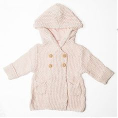 This adorable crochet knit hoodie is made with all cotton fibers and has handcrafted wooden buttons. The oversized hood is perfect for taking the chill out of cool days!