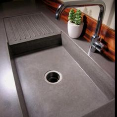 Concrete Countertops w/ built in concrete sink and drying rack - Yes please!