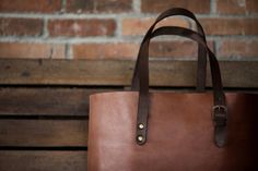 Tall Tote in Fox with Rust Handles, showing buckle to adjust handle length