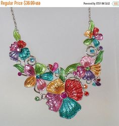 This #vintage rhinestone flower necklace is absolutely gorgeous!  It feature fabulous center swag of enamel flowers in pastel shades of green, pink, lavender, aqua blue, and... #ecochic #etsy #jewelry #jewellery