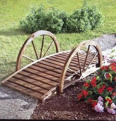 Always dreamed of a bridge in your backyard? A rustic bridge you'd expect to see gnomes crossing or fairies guarding, the wagon wheel sides and dark stain give it a weat. Front Yard Garden Design, Garden Yard Ideas, Garden Projects, Rustic Landscaping, Front Yard Landscaping, Wagon Wheel Decor, Garden Wagon, Rustic Gardens, Garden Bridge