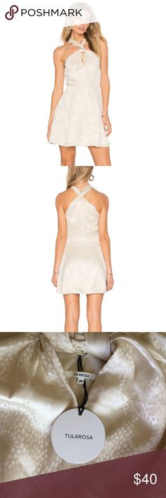 TULAROSA Doheny Ivory SILK Dress,(size XS),$178 • This is part of Tularosa collection which is well-known for their vintage-inspired looks.  • Dress up with things to do and people to see. Tularosa's Doheny Dress is cut in soft silk fabric with an airy skater skirt that's as cute as it is comfy. Knotted neck and back details add a distinct air of elegance that makes this the perfect piece for all your day and night destinations. • Self: 100% silk • Lining: 100% poly • Hand wash cold • Fully…