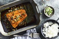 """I fell in love with Samin Nosrat's slow-roasted salmon from Salt, Fat, Acid, Heat and wanted to combine it with my other favorite fish recipe, <a href=""""https://food52.com/recipes/65218-grace-s-ginger-scallion-fish"""">Grace's Ginger Scallion Fish</a>. This recipe is the delicious result! Note: The ginger scallion flavor is pretty mild. If you want more of a punch, chop up the ginger and scallions before adding to the baking dish."""