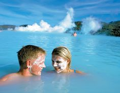 Iceland's Blue Lagoon is one of the most famous geothermal hot springs in the world.  The Blue Lagoon is filled with the bluest water because it's composed of silica, algae and minerals, which reflect sunlight and add color. Although it is said that if the water is poured into a glass, it is actually a milky color.