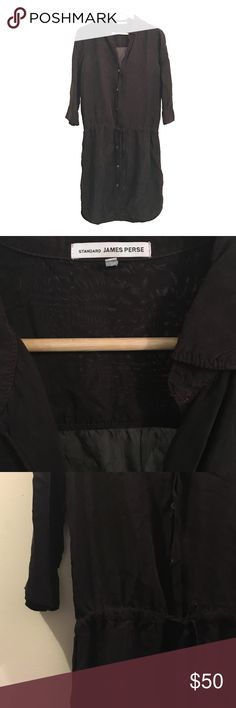 James Perse Drawstring Shirt Dress Med size 2 James Perse Drawstring Shirt Dress. Brownish black color -- almost like a dark metallic copper. There are some lighter crease marks on the dress and some underarm markings (have to go close and may still be able to be removed). Wrinkled from storage. Still a fabulous dress! Super comfy! Size 2 James Perse = medium James Perse Dresses Long Sleeve