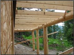 under the deck or a walk out basement in British Columbia hand peeled spruce posts. 2x6 joist.