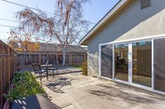 Expansive sliding glass doors open up to a large and sunny patio.