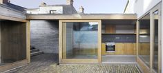 """Interior courtyard, no need for """"window treatments"""".  Truth in materials. Laneway Wall Garden House / Donaghy & Dimond Architects"""