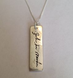 Signature or message on a vertical pendant -Made to order, via Etsy.