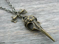 Hummingbird Skull & Bow Necklace by InkandRoses13