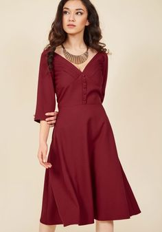 <p>Broadcast your mastery for vintage-inspired style with this burgundy dress! Throwback touches characterize this flattering frock, from its pleated bust and half sleeves, to its delicate cuff buttons and swingy skirt, pocketed skirt. A look this divine encourages instant nostalgia!</p>