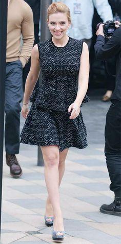 Scarlett Johansson in a sleeveless tweed dress.