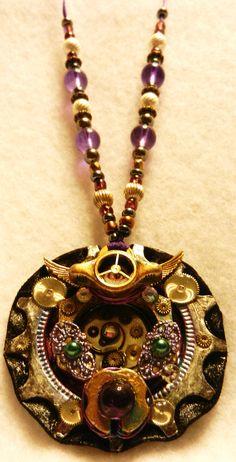 Steampunk Bike Gear Medallion Pendant, Decorative painted punk pink & purple accents, tarnished patina paint varnish, tiny watch & clock parts detailing & filigree , sterling silver & gold tone metallic beads & purple glass.