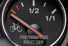 empty fuel gauge showing the image of a bicycle , symbolic photo for high petrol prices stock photo