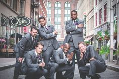 Groomsmen downtown pictures, unique photos with groom and guys at wedding, cool poses.