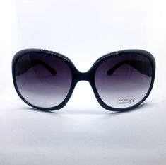 Jet black oval shaped sunglasses featuring UVA/UVB 400 protection for round, oval, long or square faces.