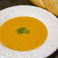 Butternut Squash Soup II - Allrecipes.com  Note: roast squash brushed with olive oil skin side down after slicing in half and scooping out the seeds in oven at 350 for 45 to 60 minutes.  Add 2 cloves sliced garlic in with veggies &  season with 1/2 to 1 tsp nutmeg a dash of cayenne and salt and pepper to taste when you add the broth.  Serve with sour cream and bacon bits.