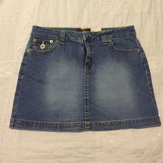 Cute little skirt. Blue jean skirt with yellow and brown stitching. No stains or tears. Worn once . Button rear pockets. Lo-rise stretch. Comes about mid thigh or a little above mid thigh Jordache Skirts Mini