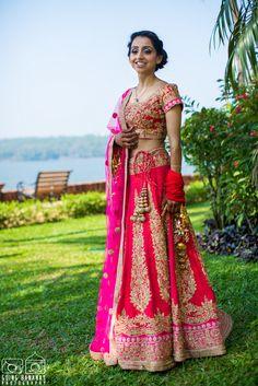 Real Indian Weddings - Shivani and Nihar | WedMeGood | Rani Pink and Onion Pink Lehenga with Gold Dabka Embroidery and Net Dupatta, Golden Lakans Picture Courtesy: Going Banana's Photography #wedmegood #lehenga #realwedding #pink